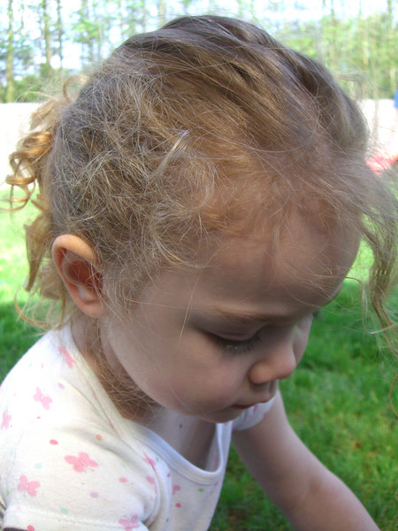 A close up of Kimber playing with the water hose in the backyard on Easter Sunday.
