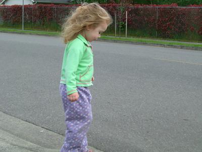 Playing on the sidewalk.