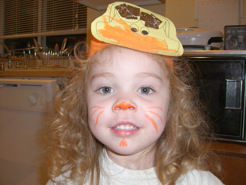 Kimber (painted like a cat by Auntie Kim) wearing the crown she made in daycare that day.