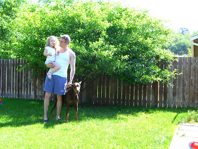 Playing with Kimber and the dogs in the backyard.