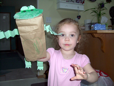 Showing off her paper frog puppet that she made in daycare that day. I think she came home from daycare with the dirty mouth. ;-)