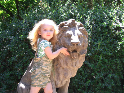 Posing with the lion statue. I'm not sure where the pose came from...feeling his teeth? Future dentist maybe?