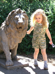 Caught running around the lion statue. She doesn't stand still for long.