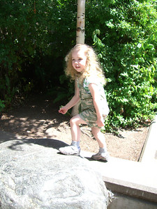 Climbing a big rock by the zoo entrance.