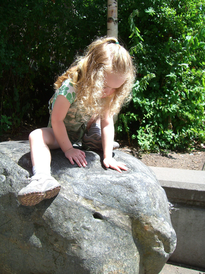 A big rock by the zoo entrance.