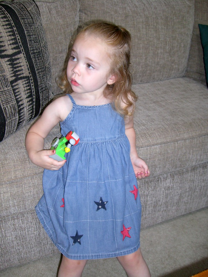 Getting ready to celebrate Drea's 17th birthday. Wearing the denim dress that Grandmama Carol got her.