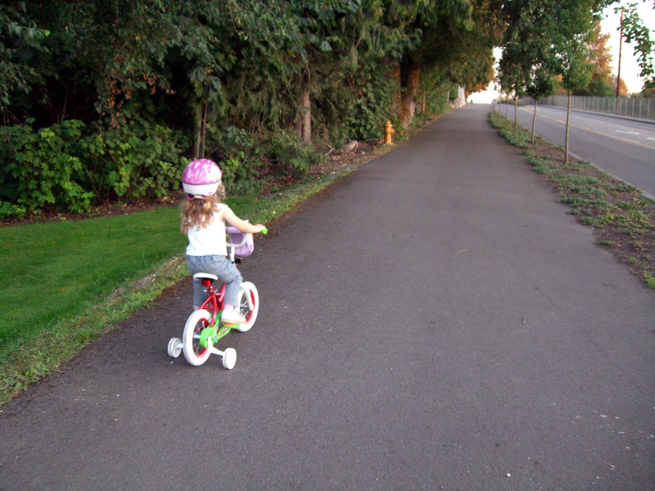 Riding her first bike!
