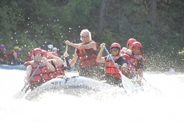 Rafting the Tieton river. On the left side you'll see me (Tod) in front and Chad behind me. On the right side we start off with Mike, Joe? (Ro's brother) and Rowlyn.