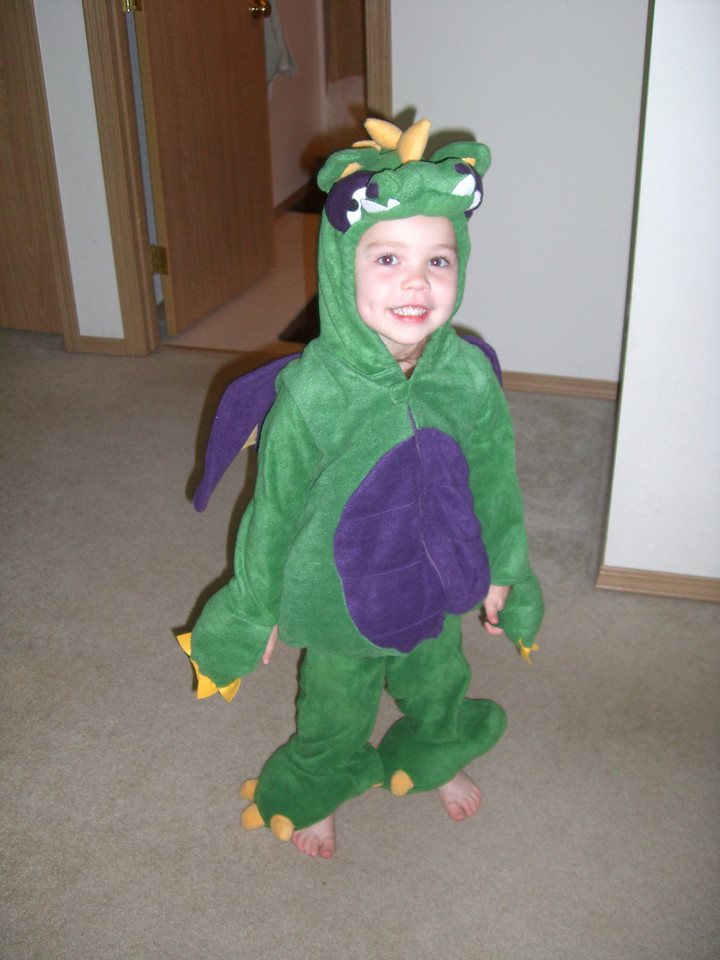 Kimber playing in her dragon Halloween costume.