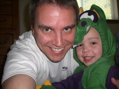 Me giving Kimber a hug while she's playing in her dragon Halloween costume.