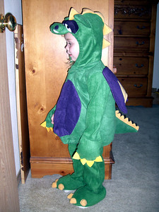Kimber playing in her dragon Halloween costume.