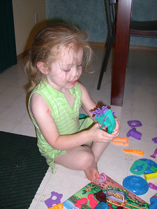 Her first big set of Playdoh...spread out over the kitchen floor.