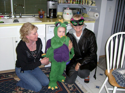 Grammy Rose, Kimber 'the dragon' and Grandmama Carol 'the cat' before trick-or-treating.