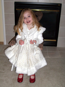 Showing off her new Christmas dress, made by Grandmama Carol.
