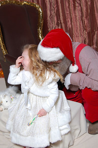 Santa tickling and playing with Kimber while she giggles up a storm.
