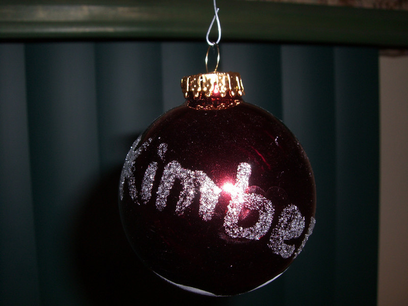 Ornament made at daycare - Her name in glitter (the same one that has Kimber's hand print around the globe)