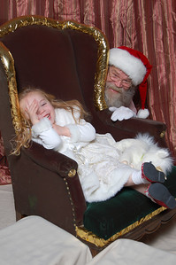Kimber and Santa playing peek-a-boo.