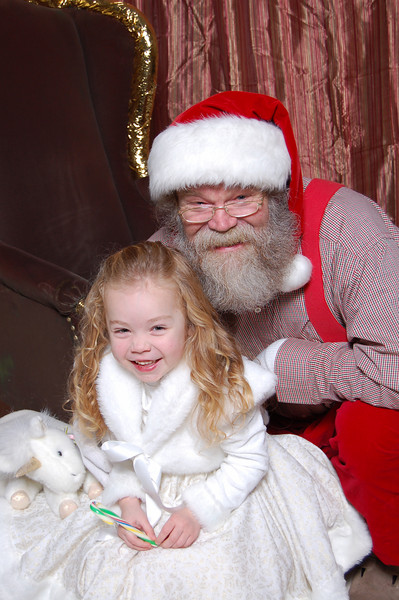 """Kimber started warming up to Santa and let him kneel next to her. We were telling her """"don't laugh"""" which of course got her giggling. :)"""