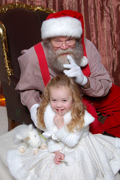 "Kimber started playing with her lip for some reason and looked like she was making the ""quiet"" gesture, so Santa joined in."