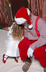 Now Kimber started laughing uncontrollably and Santa just started playing with her.