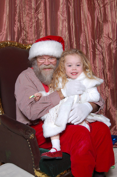 After 15 minutes of warming up and playing, Kimber finally got on Santa's lap. Of course her hair was a complete shambles by then and she was so wound up from playing that she wouldn't sit still longer than 2 seconds.  :)