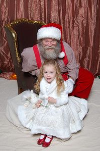 Kimber was a bit shy at first and would only sit in front of Santa.