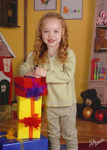 Kimber's annual pictures from daycare - Dec. '07.
