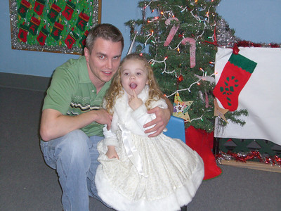 After the Christmas program. She was done posing by this point which explains the finger.