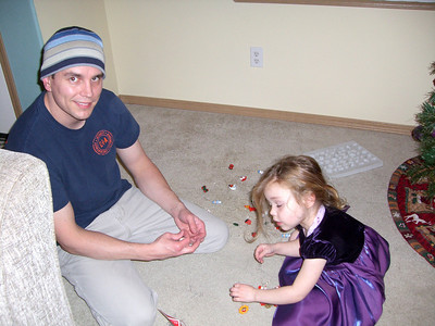 Daddy & Kimber putting hooks on all the little ornaments.