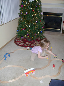 Playing trains while decorating the tree.