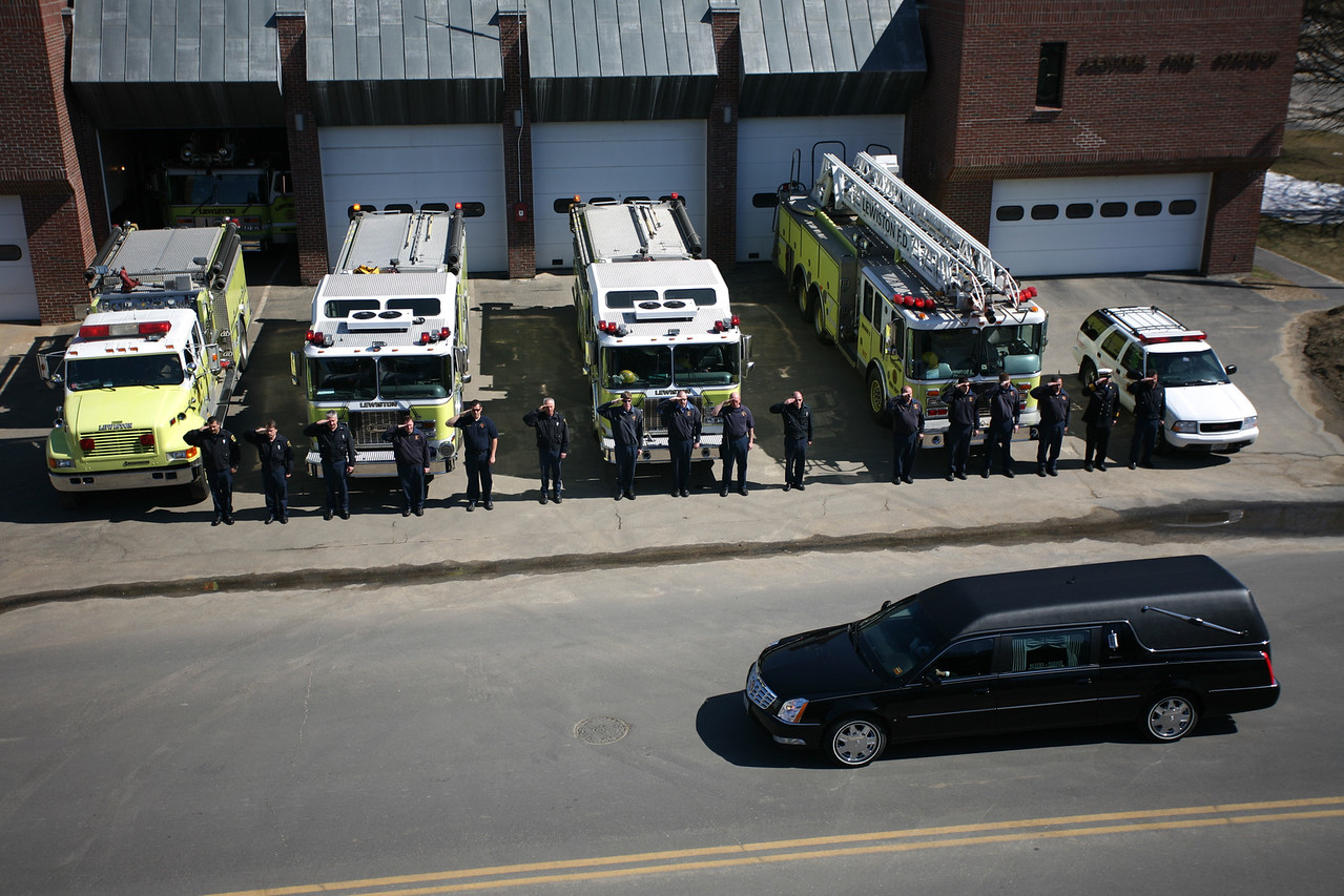 (photo:Lincoln Benedict) Former Lewiston Police Chief Roland Dumais' hearse passes by the Lewiston Central Fire Station with full honors.