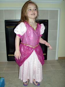 Modeling her new Sleeping Beauty costume (made by Grandmama Carol).