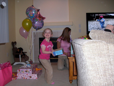 Opening presents (I must have said something cuz she's looking up at me while I'm taking video).