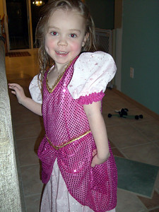 Modeling her new Sleeping Beauty costume (made by Grandmama Carol).