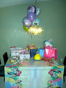 The table full of presents and cake.