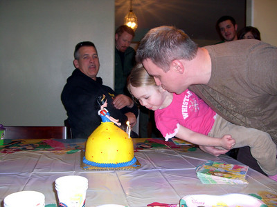 She needed a little bit of help blowing out the candles.
