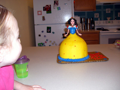 Can you believe that's a real birthday cake with a real Snow White 'Barbie' doll inside?