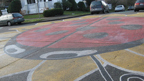 A huge ladybug painted in an intersection in the Fremont area.