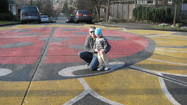 Standing on the ladybug's eye [A huge ladybug painted in an intersection in the Fremont area].