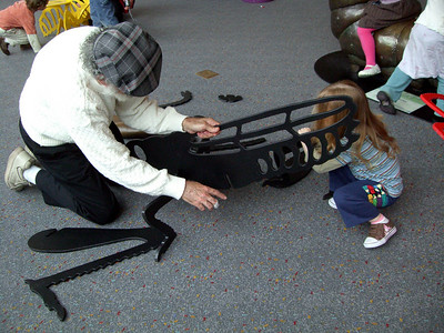 Putting together a grasshopper at the Pacific Science Center.