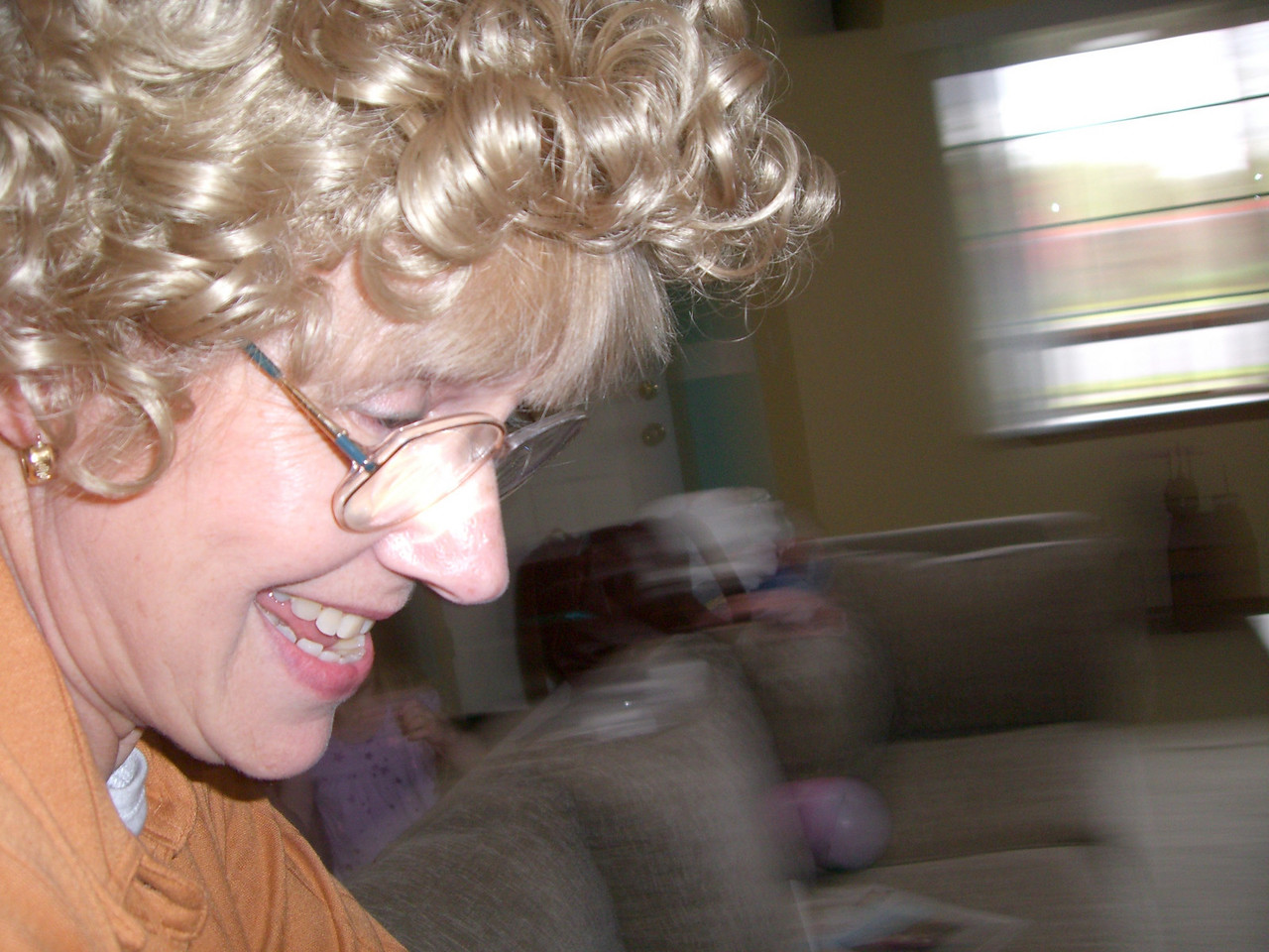 Mom (in the wig) tries to run away as Whitney snaps a picture.