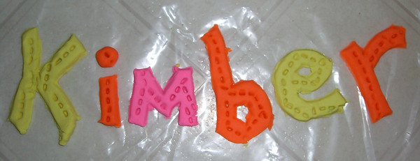 We made this out of playdoh. I (daddy) made the letters and Kimber added the dots.