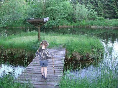 Playing at the pond at Papa's.