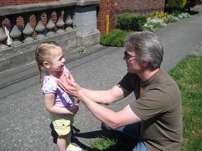 Zoo - putting sunscreen on the peanut. Father's Day '08