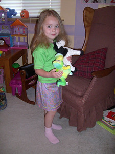 Modeling the shirt and skirt made for her by Grandmama Carol.