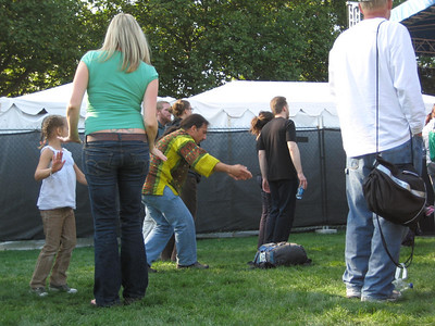 Crazy dancing guy (in the yellow shirt).