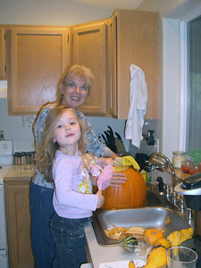 Gutting the pumpkin in preparation for carving.