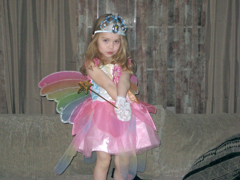 Playing in her fairy costume from Grandmama Carol and Papa Ben.