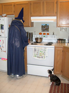 Halloween '08 - Ben cooking pumpkin seeds while Chloe hopes for something to drop. It was a game the whole visit...whether or not Ben would drop something for little Chloe.