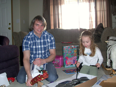 Opening my gift while Kimber plays her drums.